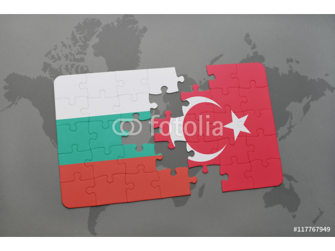 puzzle with the national flag of canada and burkina faso on a world map background. 64238