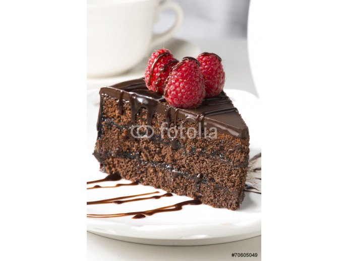 Slice of chocolate layer cake with  berries and chocolate sauce 64238