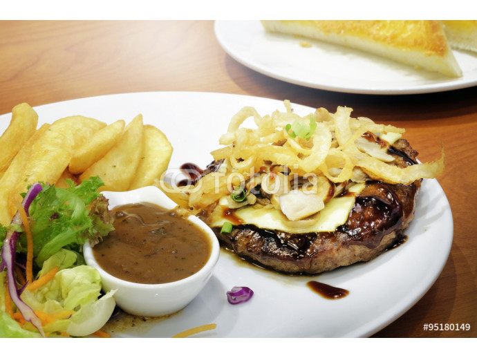 Beef steak serve with french fries and salad 64238
