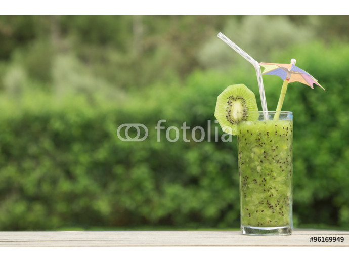 Glass of fresh kiwi smoothie on a table  64238