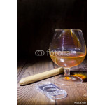 Cognac in glass and cigar 64238