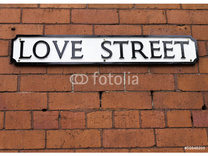 Love Street Sign on a red brick wall 64238