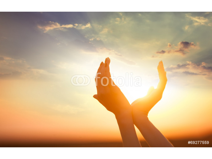 hands holding the sun at dawn 64238