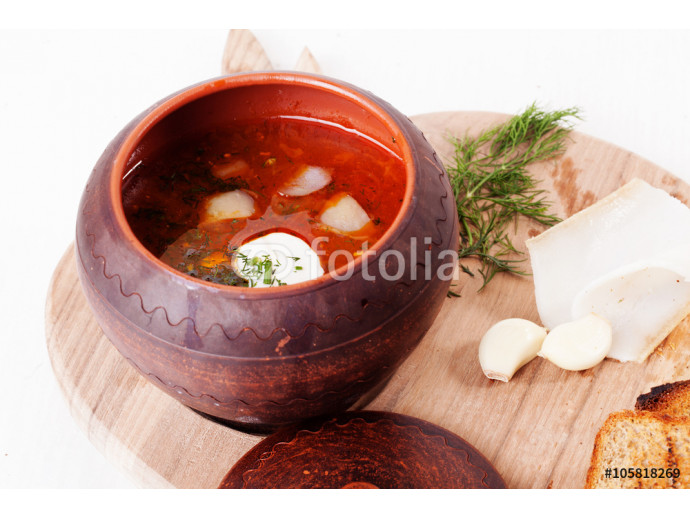 borscht soup pot with sour cream and dill top wooden board beet white background 64238