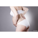 Caucasian pregnant woman in white lingerie with abdominal pain on gray studio background 64238