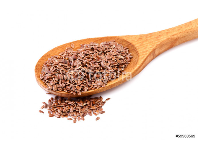 Flax seeds, linseeds on a wooden spoon 64238