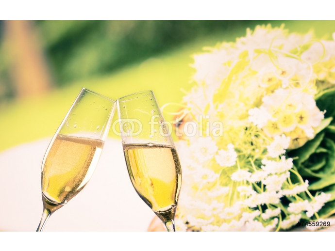 champagne flutes on wedding flowers background 64238