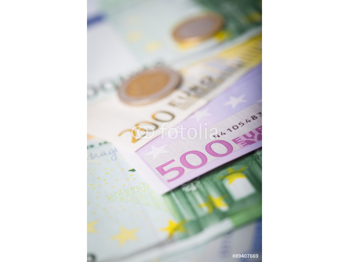 Closeup of euro banknotes and coins 64238