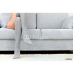 Woman with beautiful legs sitting on sofa. 64238
