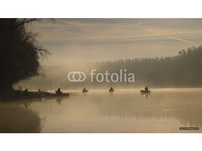 People fishing in the early morning on the lake 64238