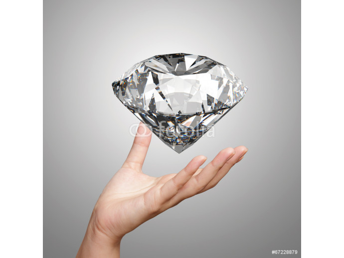 hand holding 3d diamond over white background 64238