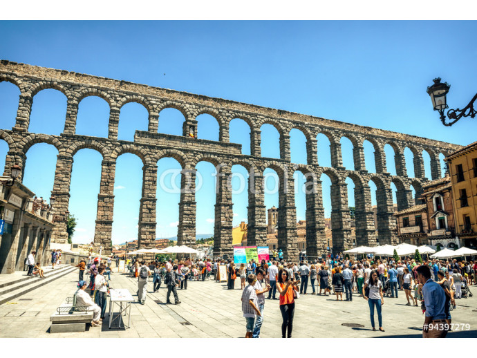 Segovia, Spain - June 29, 2014: People around the famous ancient 64238
