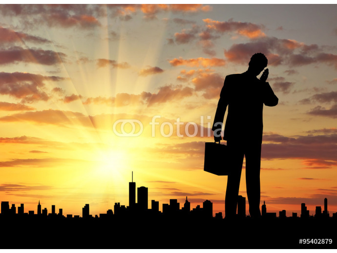 Fotomural decorativo  Silhouette of  businessman talking on the phone 64238