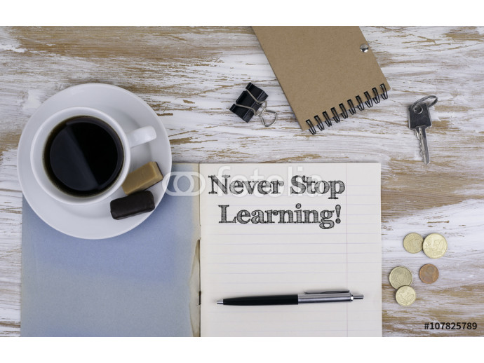 Never stop learning! Copybook on the desktop. 64238