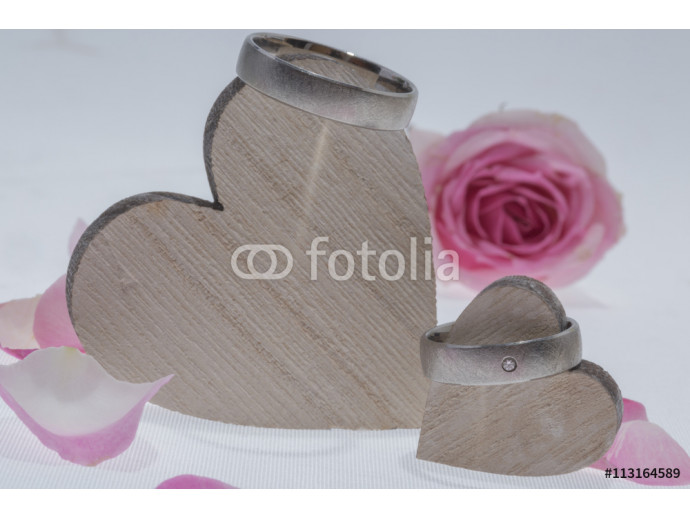 wedding rings with a rose on white background 64238