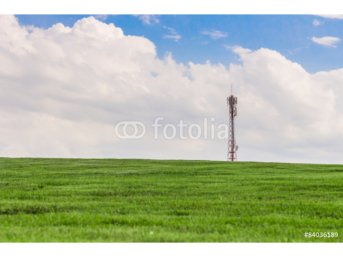 antenna on the grassy knoll and blue sky. 64238