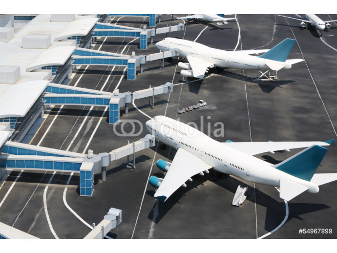 Models of modern white aircraft standing at miniature airport. 64238