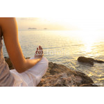 young woman meditation in a yoga pose on the tropical beach 64238