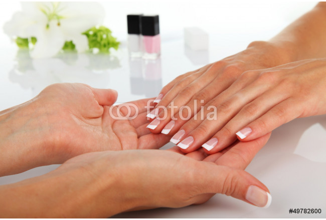 Woman in a nail salon receiving a manicure 64239