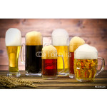 Variety of beer glasses on a wooden table 64239