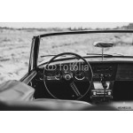 Steering wheel and dashboard in interior of old automobile. 64239