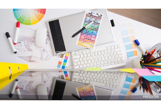 Modern office workplace with digital tablet, notepad, colorful p 64239