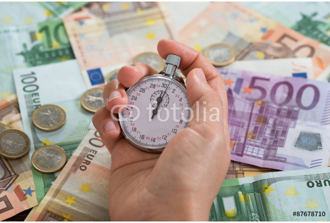 Person Hands With Stopwatch Over Money 64239