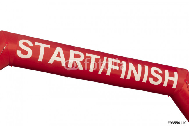 A Red start and finish line inflatable banner isolated against white a background. Banner was marking the start of a 5K run but could be used for any purpose. 64239