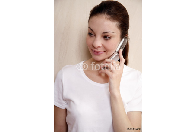 Woman talking on cell phone 64239