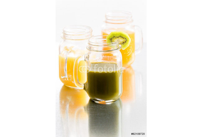 Glass jars of fresh tropical fruit juice 64239