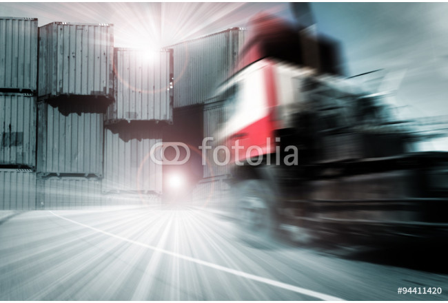Generic big trucks speeding on the highway at sunset - Transport industry concept , big truck containers 64239