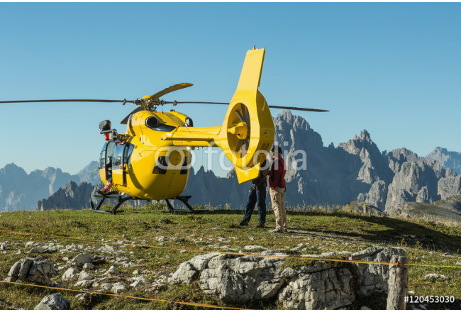Yellow helicopter used for rescue operations, On the ground in Dolomites, Italy. Helicopter rescue 64239