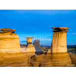 Hoodoos bathed in the warm light of a summer sunset at Drumheller Alberta Canada. 64239