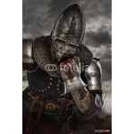Thoughtful knight over dark clouds background. 64239
