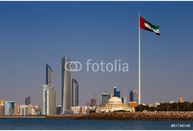 A skyline view of the Abu Dhabi including the UAE National Flag 64239
