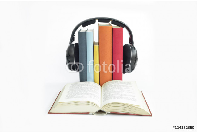 Group of books and headphones related to audio books with isolated background 64239