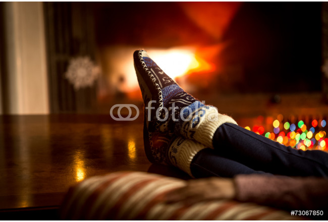 portrait of feet at woolen socks warming at fireplace in winter 64239