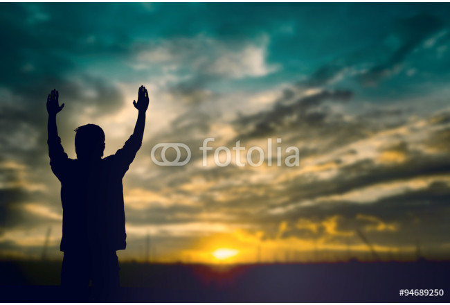 Silhouette of man with raised hands over blur cross concept for 64239