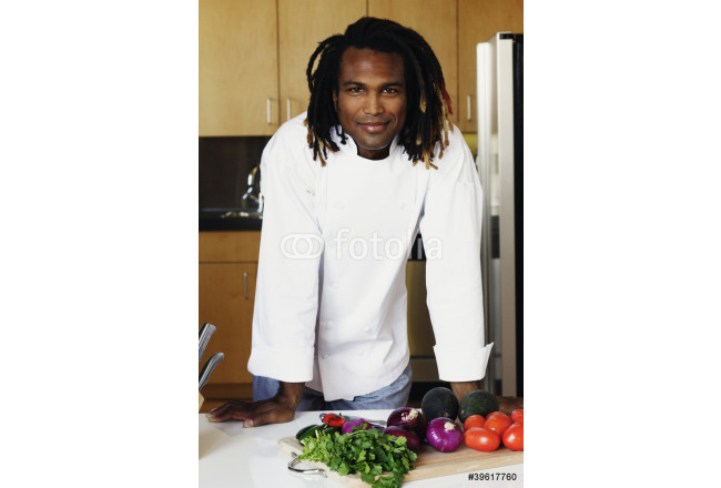 Portrait of male chef standing in kitchen 64239