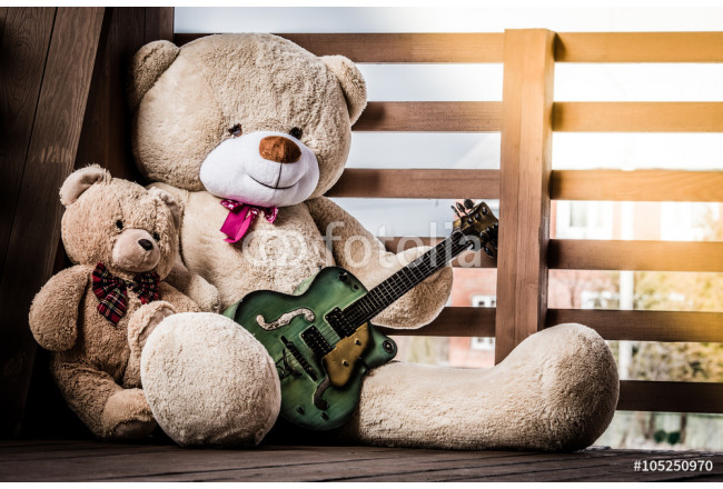 Family of fluffy teddy bears with a guitar. 64239