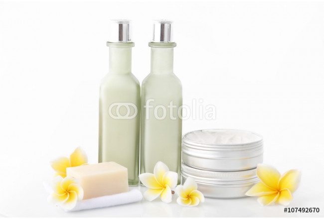 Set of different cosmetic product with frangipani flowers 64239
