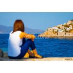 Woman looking at Hydras port in Greece Saronikos Gulf. 64239