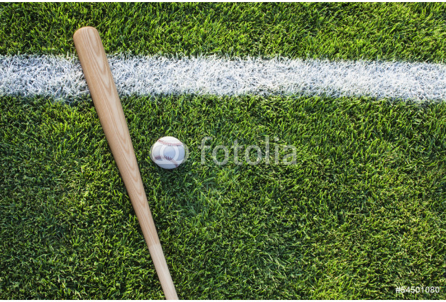 Baseball bat and ball on grass field viewed from above 64239