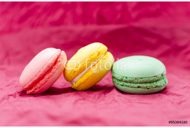 French macaroon colorful on burgundy background 64239