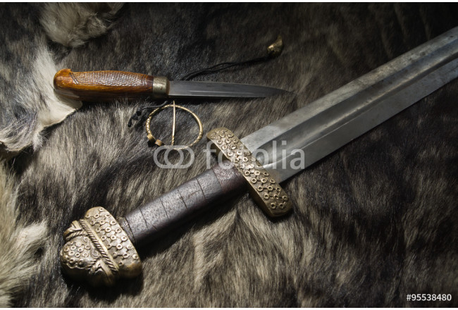 Viking sword and knife on a fur 64239