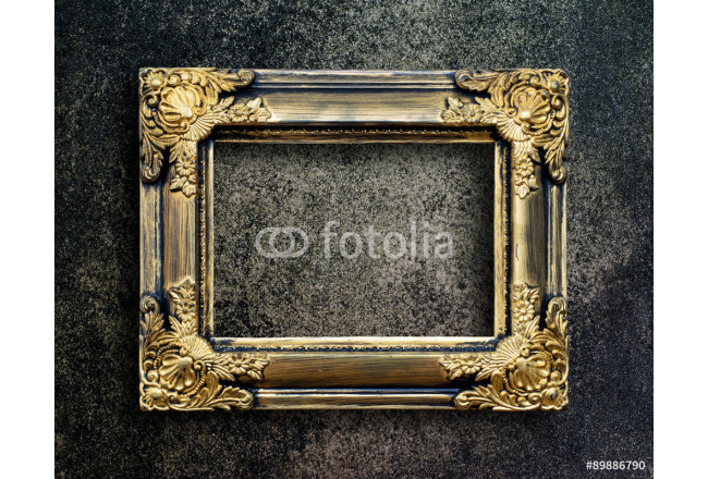 Old picture frame on grunge wall. 64239