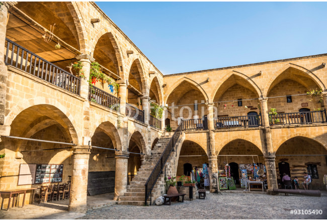 NICOSIA, CYPRUS - AUGUST 10, 2015: Buyuk Han (The Great Inn) a touristic center with an antique souvenir shops, craft workshops and cafes in Nicosia, Cyprus on August 10,2015 64239