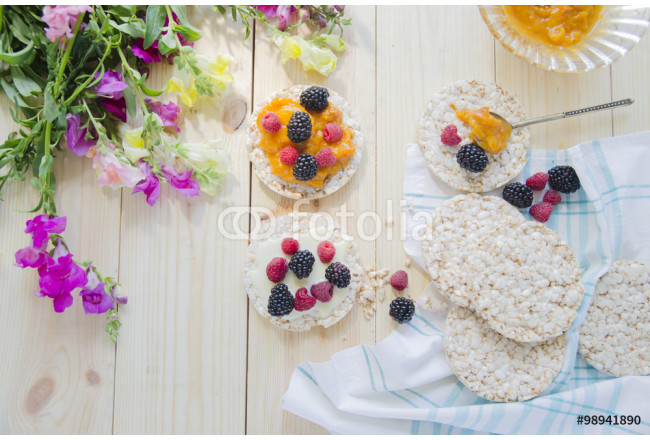 Rice cakes with jam and berries for breakfast 64239