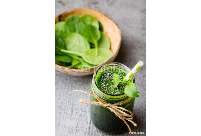Spinach smoothie, on the grey  background. 64239