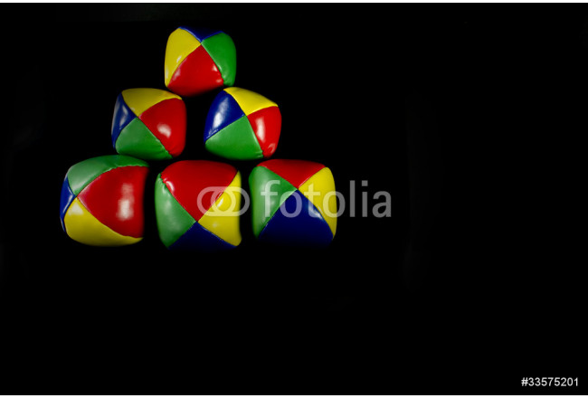 Pyramid juggling balls on a black background 64239